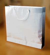 Papírové tašky s laminem o rozměru 540 x 120 x 500 mm, bílé