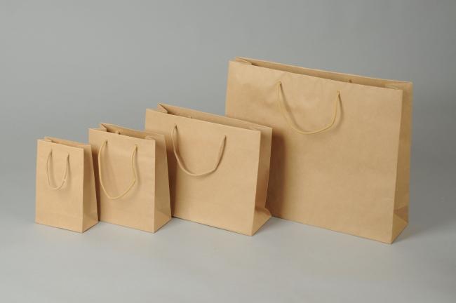 Papírová taška o rozměru 160 x 80 x 250 mm,hnědý sulfátový papír, bavlněné držadlo